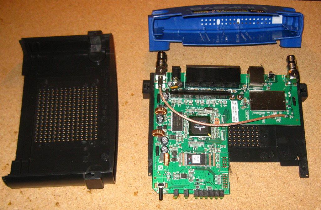 wrt54gl dual serial port and sd card mods jbprojects net disaasembly 1 remove the void warranty sticker 2 unscrew the two wifi antennas the front blue faceplate snaps apart from the black body